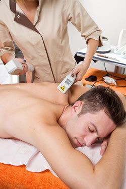 Man having laser hair removal on back