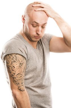 Man with tattoo on right arm