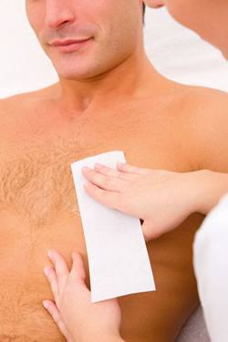 Man having his chest waxed