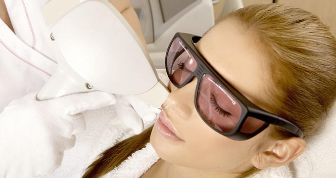 Woman has laser hair removal on face