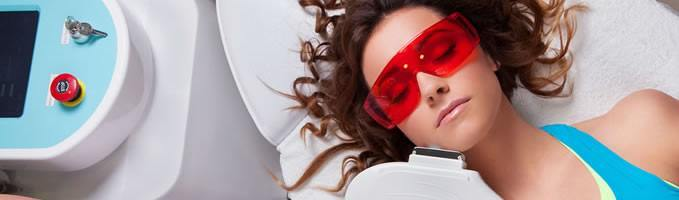 Woman having laser hair removal on her face