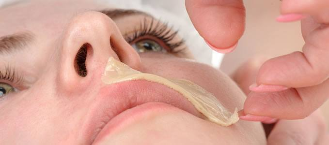 Woman having upper lip waxed