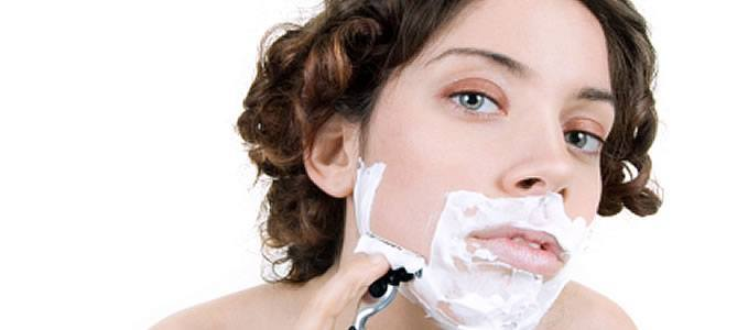 Woman shaving face